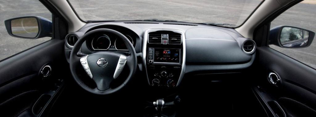front interior of 2019 nissan versa including steering wheel and infotainment system