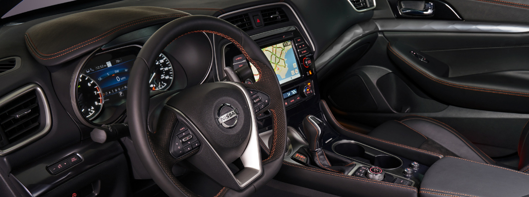 front interior of 2019 nissan maxima including steering wheel and infotainment system