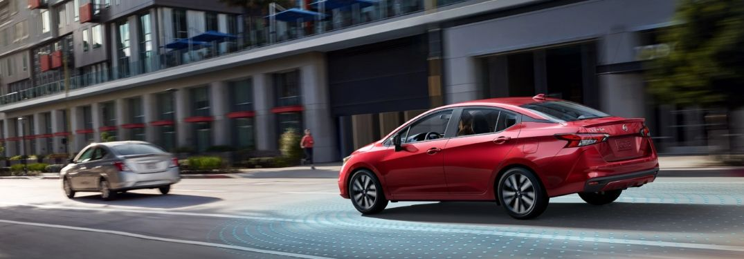 2020 Nissan Versa on city street with sensor graphic