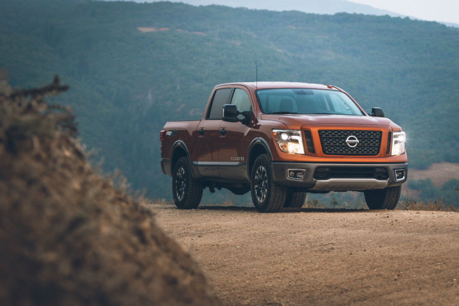 A photo of the Nissan Titan on a dirt road.