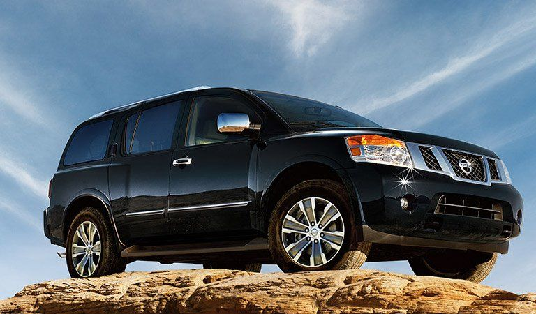 A photo of the Nissan Armada parked on some rocks.