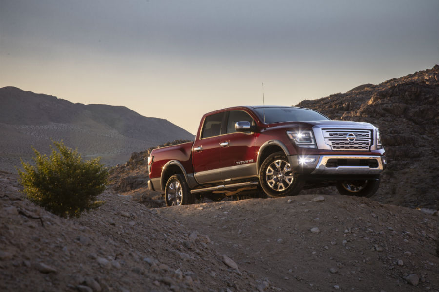 A right profile photo of the 2020 Nissan Titan parked on a hill.