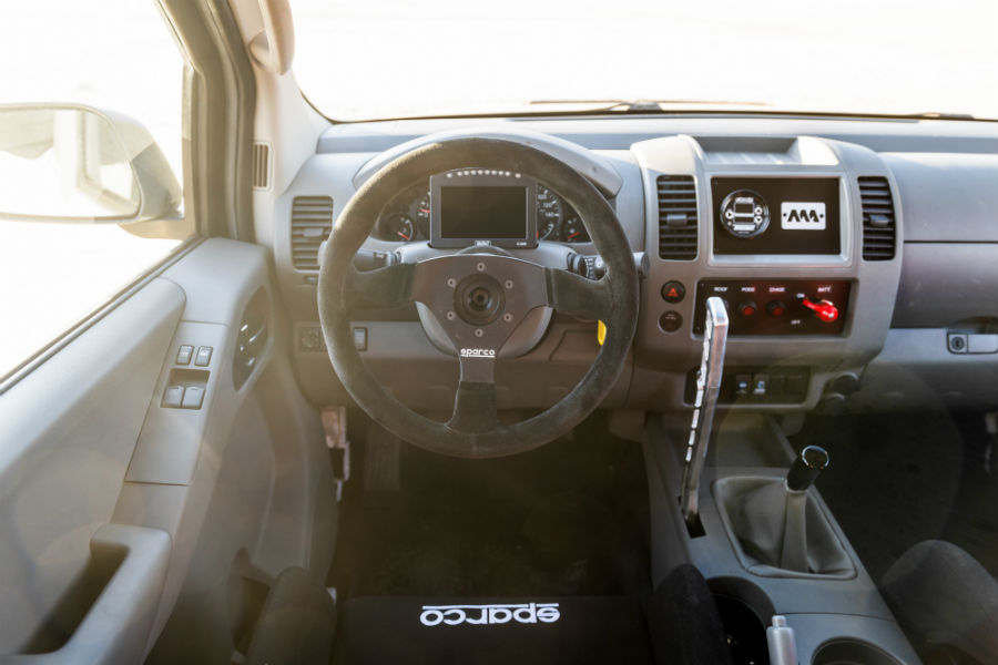 A photo of the driver's cockpit in the Nissan Frontier Desert Runner.