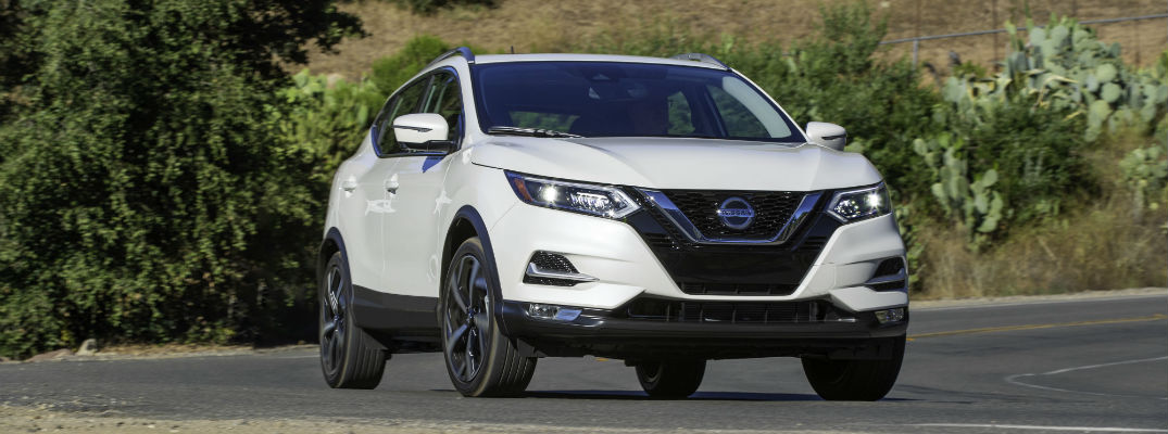 A head-on photo of the 2020 Nissan Rogue Sport parked on the road.