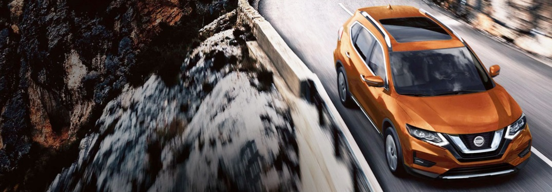 2020 Nissan Rogue driving through the mountains