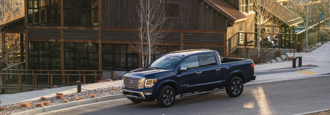 2021 Nissan TITAN parked in front of a large wood house