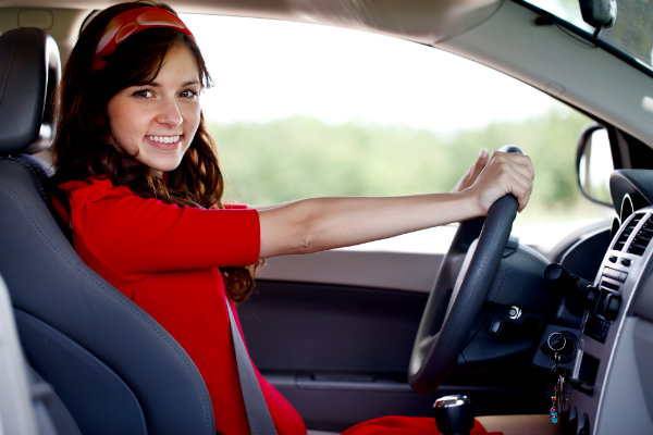 Teen driver wearing a red dress