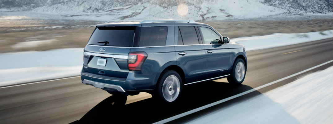 Ford Expedition driving down a highway in the winter
