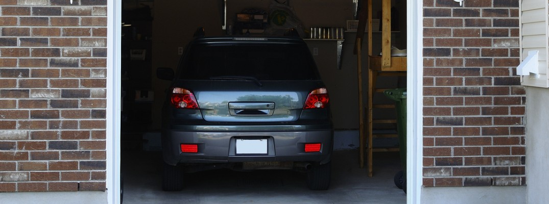 Rear view of vehicle parked in garage for winter