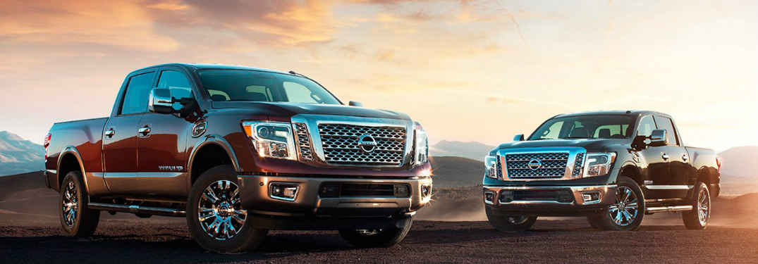 Two 2017 Nissan Titans parked in gravel at sunset