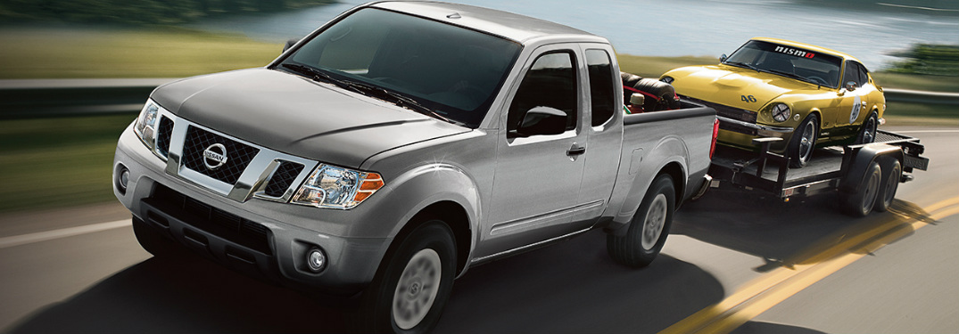2018 Nissan Frontier towing a vintage car