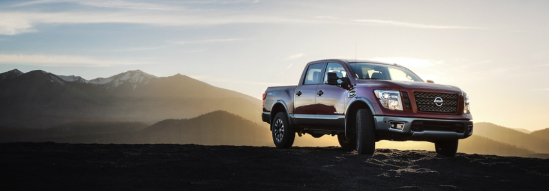 ... 2018 Nissan TITAN Parked In Front Of Mountains At Sunrise
