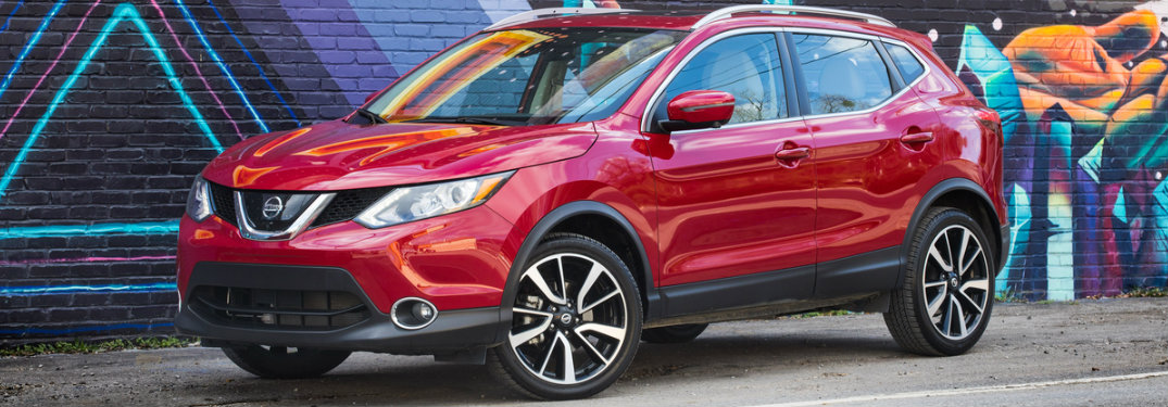 2018.5 Nissan Rogue Sport parked in front of a colorful mural