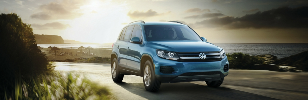 2017 Volkswagen Tiguan Limited with sun shining behind it on road