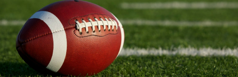 Brown football on football field