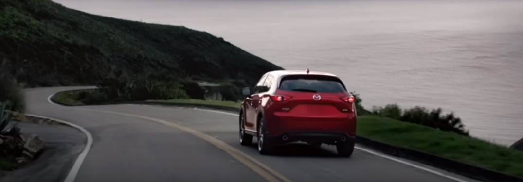 Red 2018 Mazda CX-5 Driving on a Coastal Road
