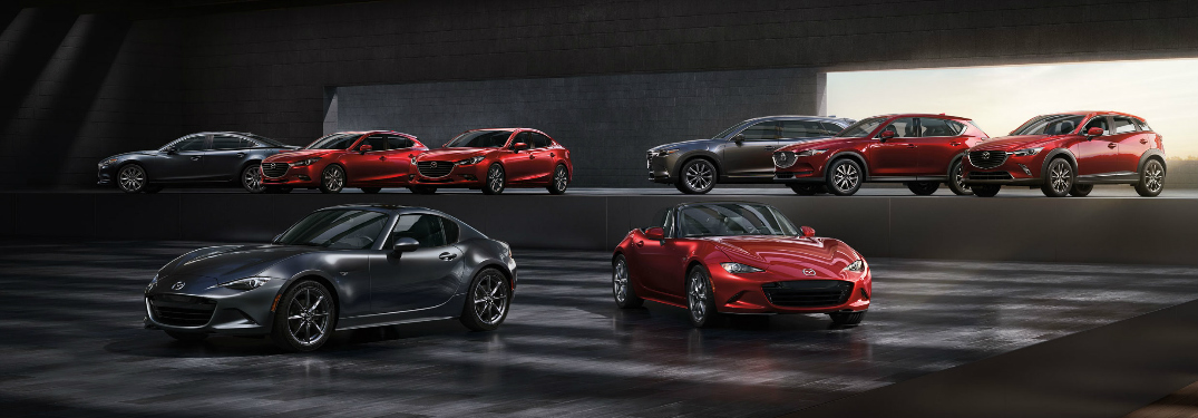 Full line-up of Mazda models in a showroom