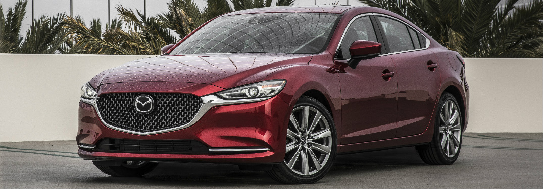 Red 2019 Mazda6 parked in front of some palm trees