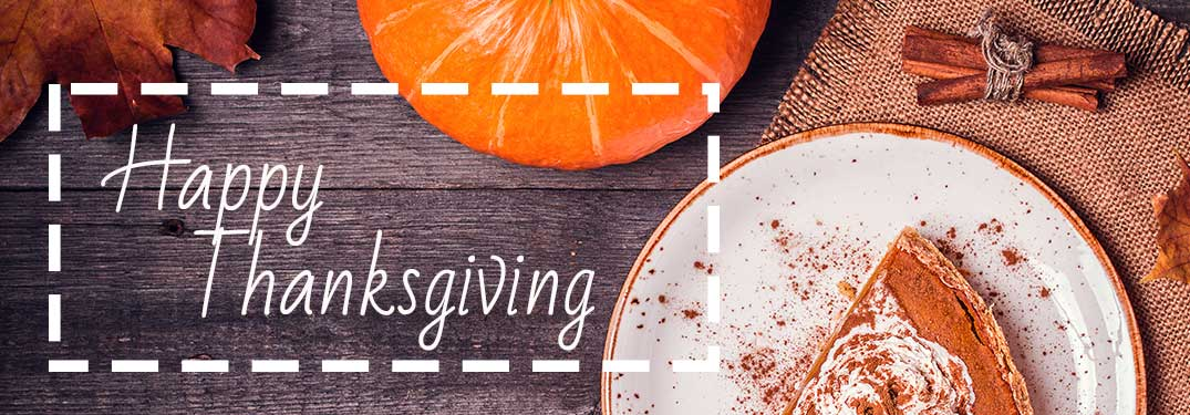 """Table with half-eaten pie and """"Happy Thanksgiving'"""" white text"""