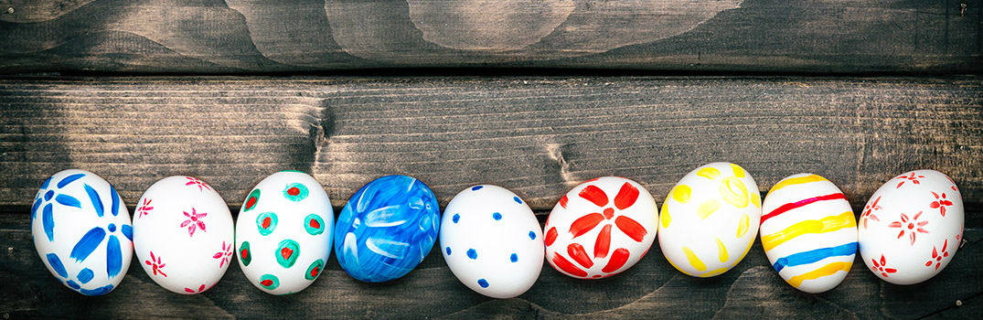 Colored Easter Eggs on Wooden Table