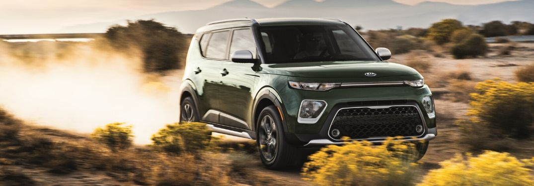 2020 Kia Soul driving down dirt road from exterior front passenger side