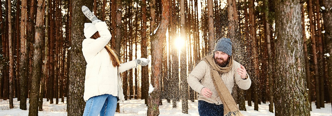 Couple smiling outside during winter