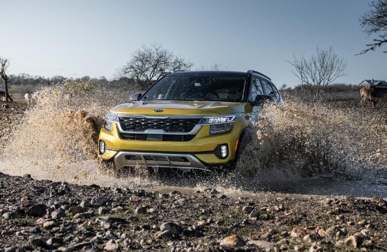2021 Kia Seltos driving through mud