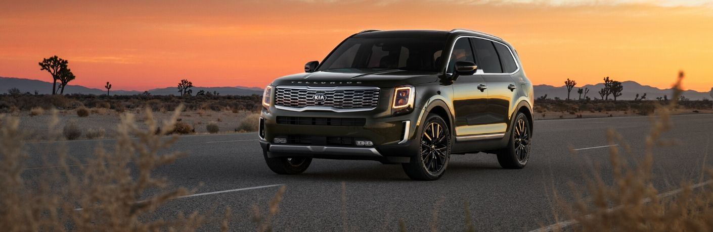 2020 Kia Telluride driving with the sunset in background