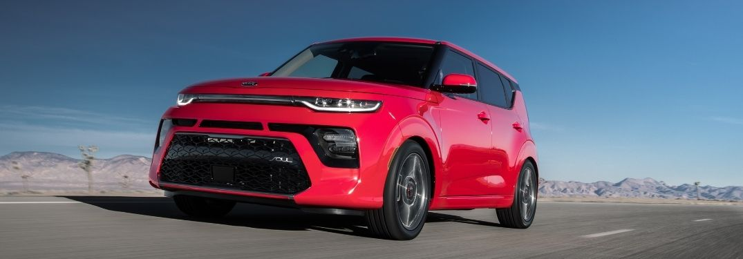 Red colored 2021 Kia Soul on road