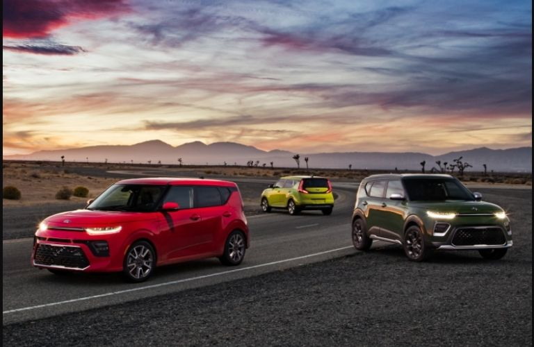 Three 2021 Kia Soul models parked next to each other