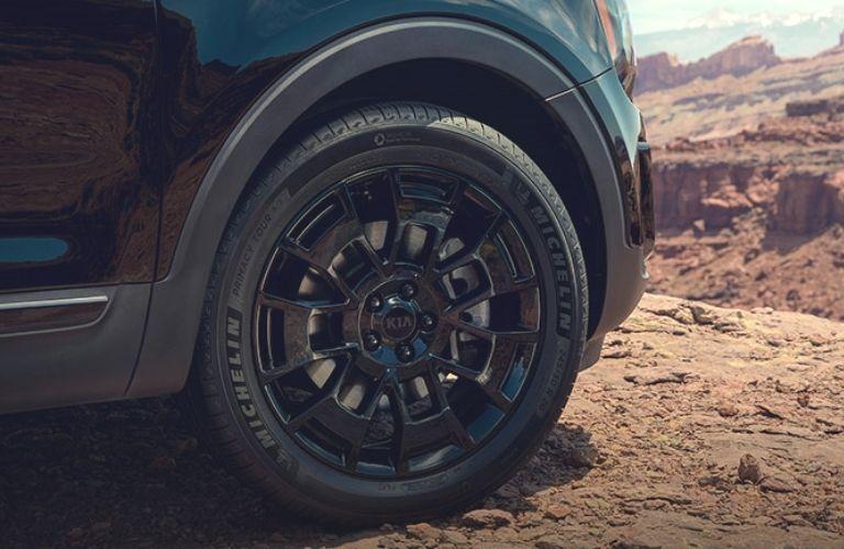 2022 Kia Telluride wheel image on mountain terrain