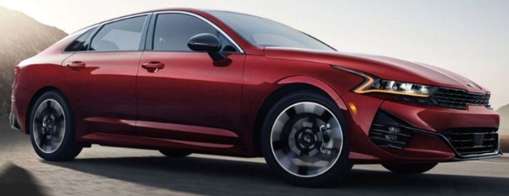 An angled profile of the 2022 Kia K5 on the road