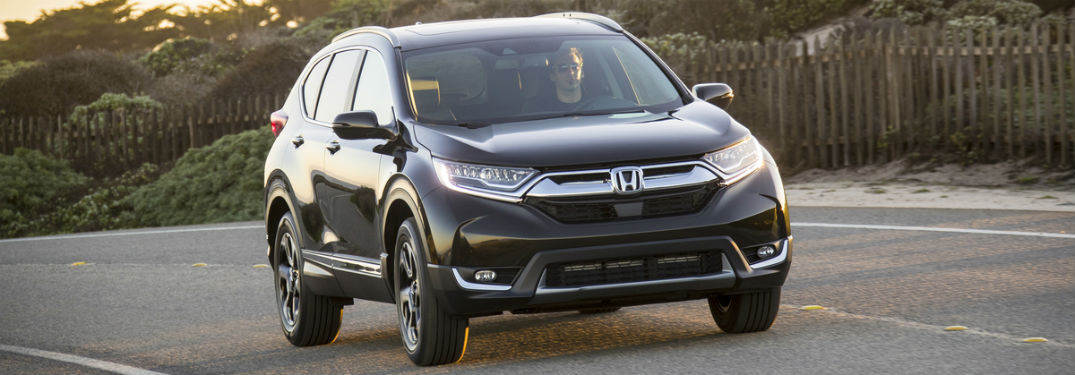 Front passenger side exterior view of a gray 2019 Honda CR-V