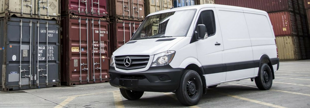 mercedes-benz sprinter van by shipping containers