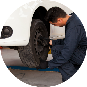 man changing vehicle tire