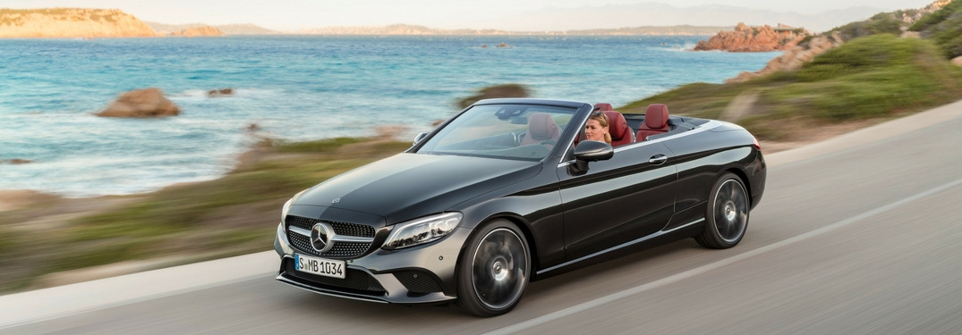 2019 mercedes-benz c-class coupe driving by water
