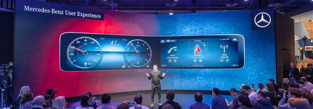man highlighting the features of the new mercedes-benz user experience