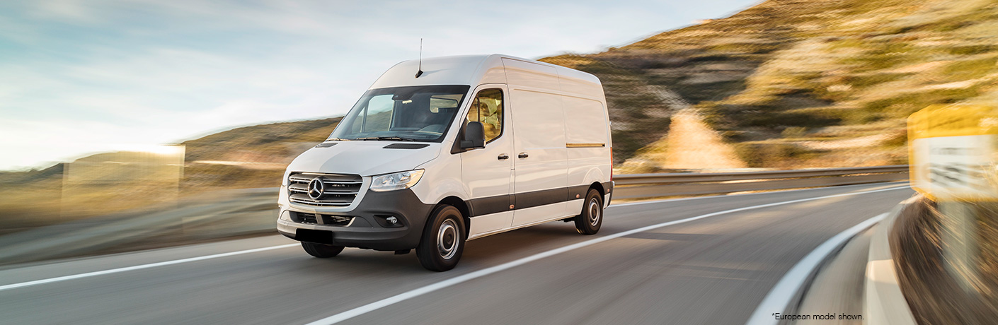 white 2018 mercedes-benz sprinter on road