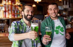 two men toasting with green beer