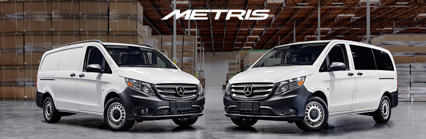 two white metris vans