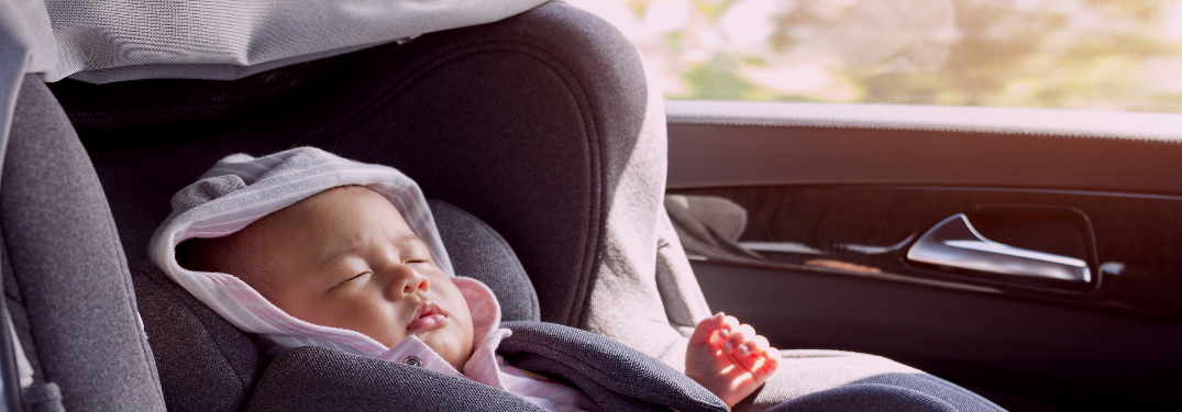 baby sleeping in a car