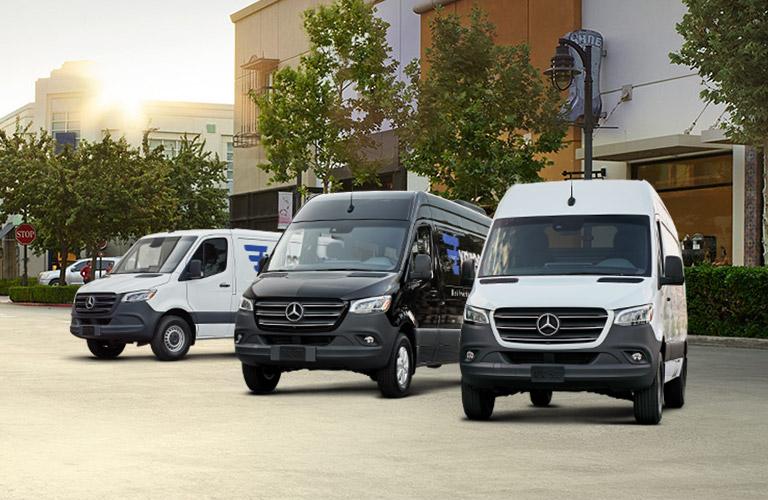 three mercedes-benz sprinter passenger vans