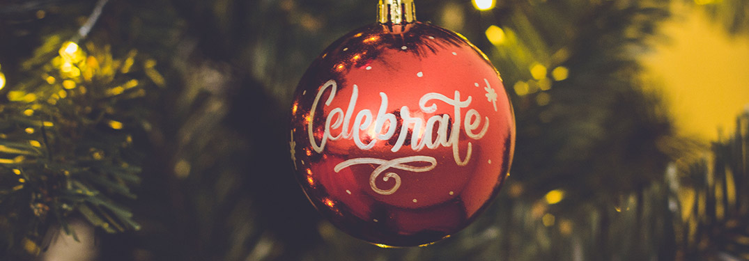 red ornament that says celebrate