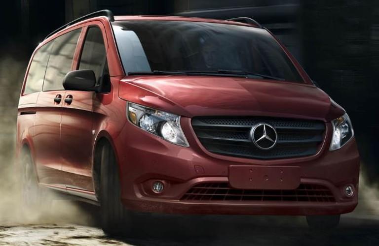 red Mercedes-Benz Metris Passenger van