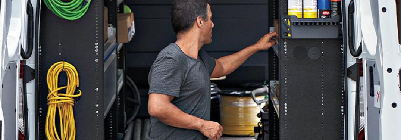 a man loading a Mercedes-Benz van