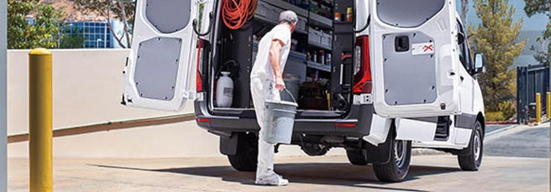 2021 Mercedes-Benz Sprinter Cargo Van with a man and a bucket