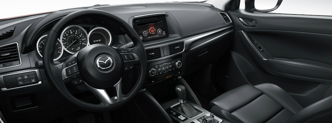 Why is the steering wheel in my Mazda hard to turn?