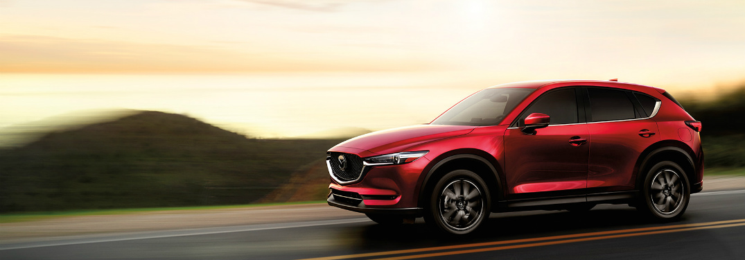 2017 Mazda CX-5 red cruising on a highway side view