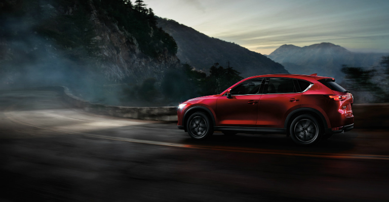 2017 Mazda CX-5 red going through twisty mountain roads