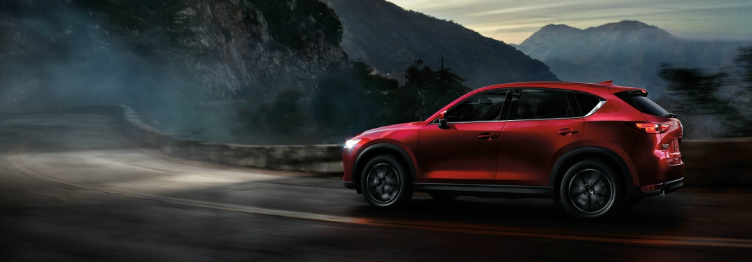 2018 Mazda CX-5 red side view driving through twisty mountain roads